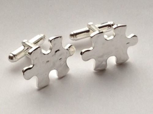 Silver Jigsaw Puzzle Piece Cufflinks hammered. Each cufflink is shaped a s jigsaw piece and had a hammered effect finish. With T-Bar and fully hallmarked and gift boxed.