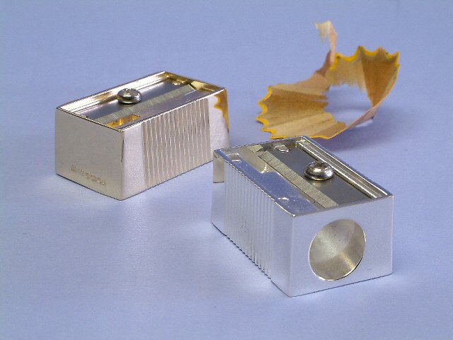 a silver pencil sharpener which is made to a standard size sharpener